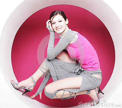 Woman posing in pink circle