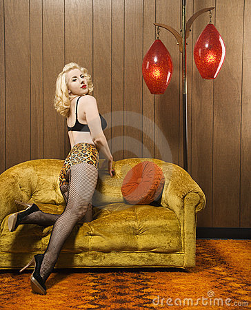 Woman posing on retro couch.