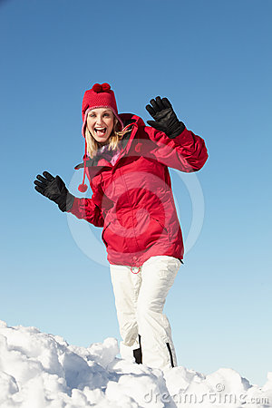 Woman Posing In Snow On Ski Holiday In Moutains