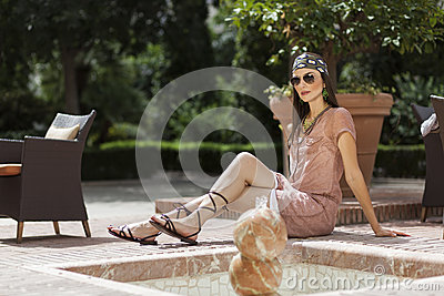 Woman posing with sunglasses