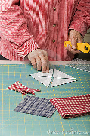 Woman positioning cut triangle fabric.