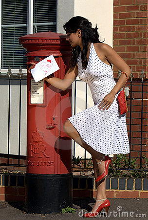 Woman posting love letter