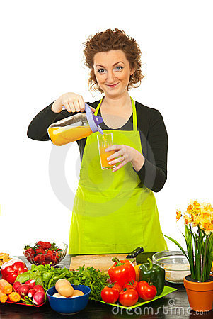 Woman poured orange juice in glass
