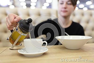 Woman pouring buckthorn tea Stock Photo