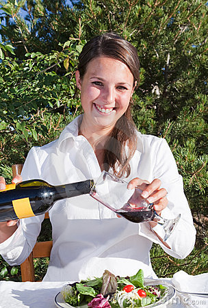 Woman pouring red wine