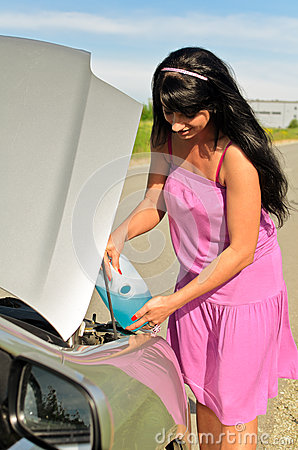 Woman pours a liquid to the car