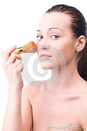 Woman with powder brush