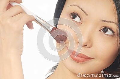 Woman and powder brush
