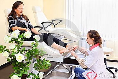 Woman practices chiropody taking care of feet