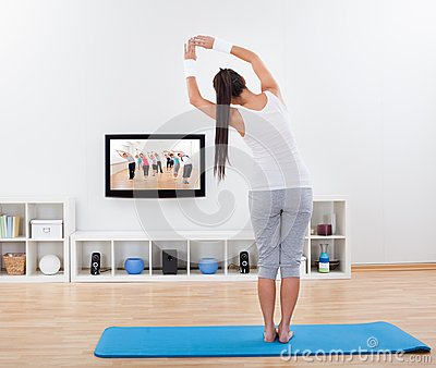 Woman practicing yoga at home stock photo image 47186644 for Living room yoga timetable