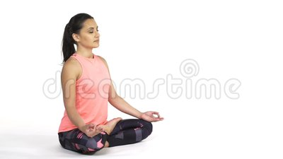 woman practicing yoga padmasana lotus pose stock footage
