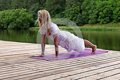 Woman practising yoga exercise
