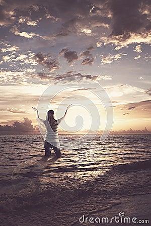 Woman praising in the ocean