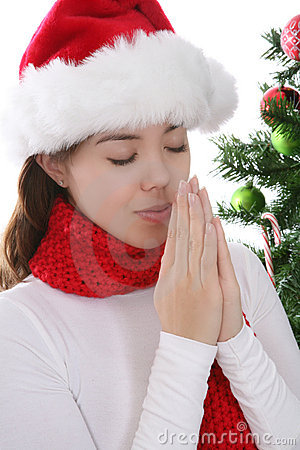 Woman praying at Christmas