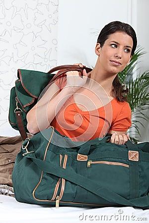 Woman prepapring to pack bags