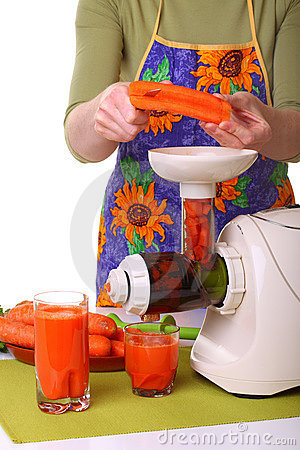 Woman prepare Juice extractor and carrot