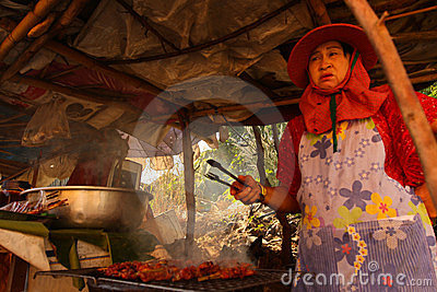 A woman prepares food street Editorial Stock Photo