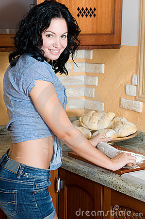 Woman preparing dough for bread