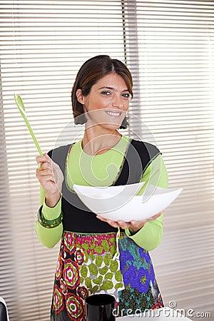 Woman preparing food at the kitchen