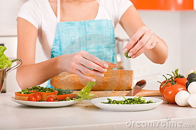 Woman preparing fresh healthy sandwiches in h