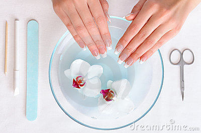 Woman Preparing hands for manicure procedure