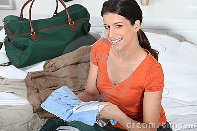 Woman preparing luggage