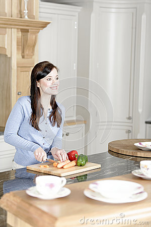 Woman preparing a meal in the kitchen