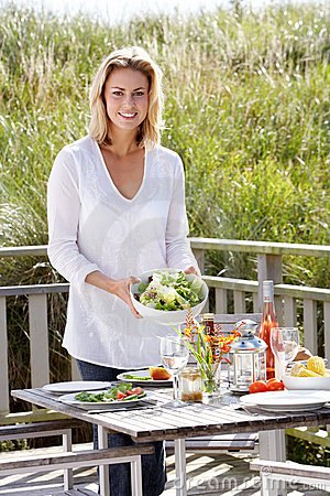Woman preparing meal outdoors
