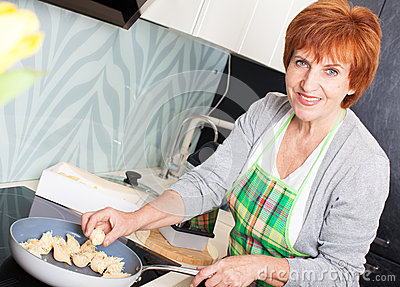 Woman preparing pasta with cheese
