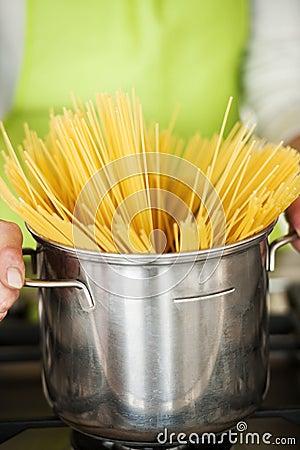 Woman Preparing Spaghetti In Pot