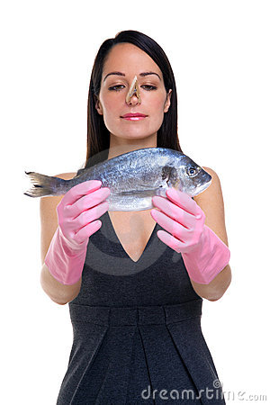 Woman preparing to cook fish