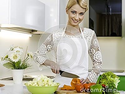 Woman preparing vegetarian salad