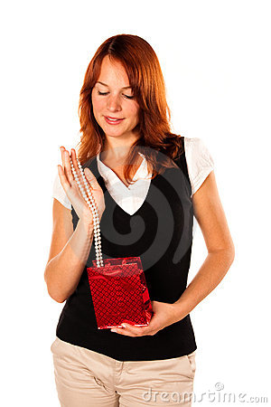 Woman with present - necklace. Frontal shot
