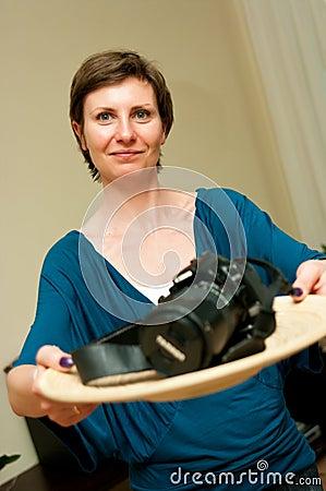 Woman Presenting a Camera