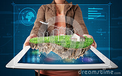 Woman presenting a perfect ecology land with a house and windmil