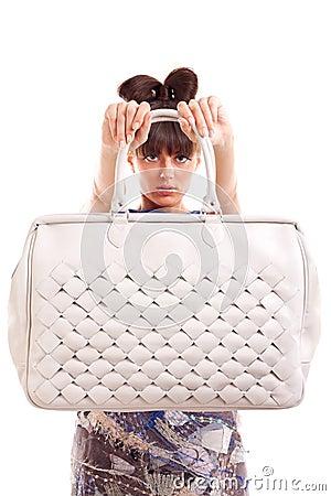 Woman presenting purse