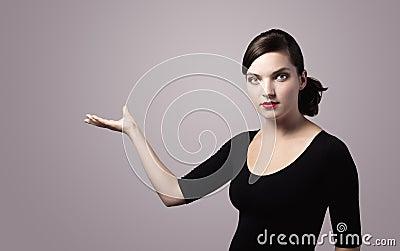 Woman presenting something imaginary