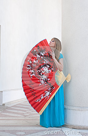 The woman presses to itself the big fan