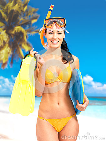Woman with protective swim mask and flippers