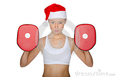Woman protects herself in Santa Claus hat