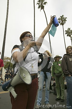 A woman protester with a loud speaker Editorial Photo