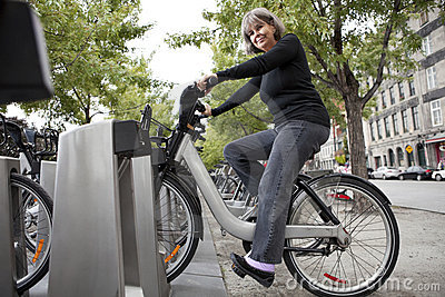 Woman on a public bicycle