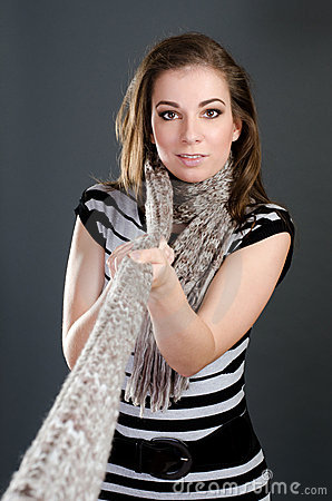 Woman pull scarf