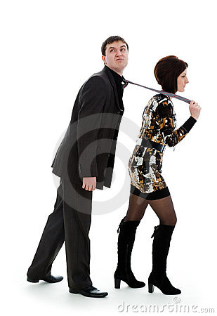 Woman pulls a young man in a tie, young man.
