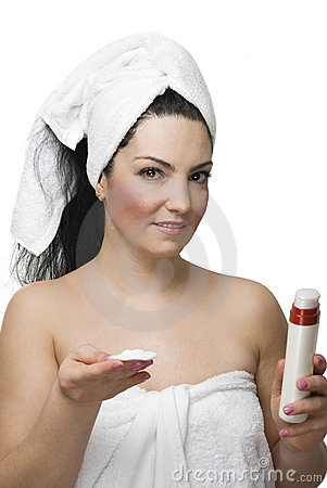 Woman with pure cotton cosmetic pads with cream