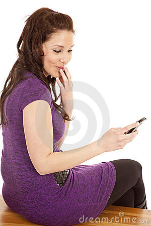 Woman in purple back smirk phone