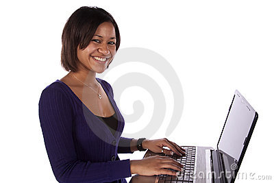 Woman in purple on laptop smiling