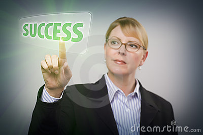 Woman Pushing Success on Interactive Touch Screen