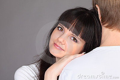 Woman put her head on shoulder of man