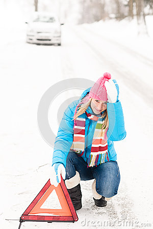 Woman put warning triangle car breakdown winter